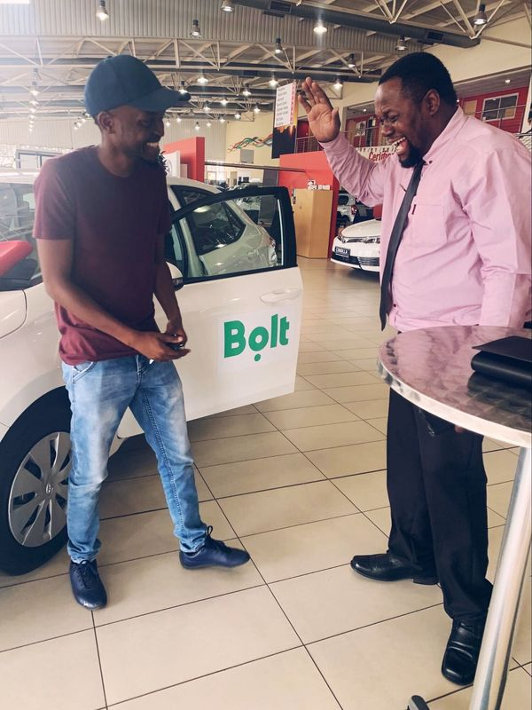 Bolt driver Moses with his new car