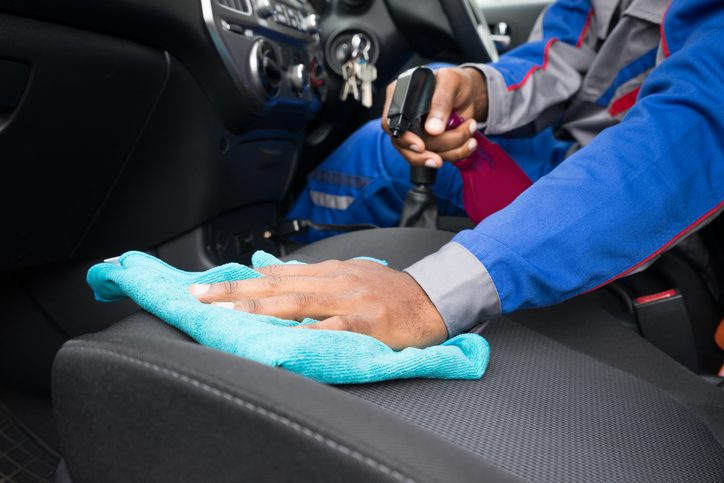 Close-up Of A Male Worker Cleaning Seat Inside The Car
