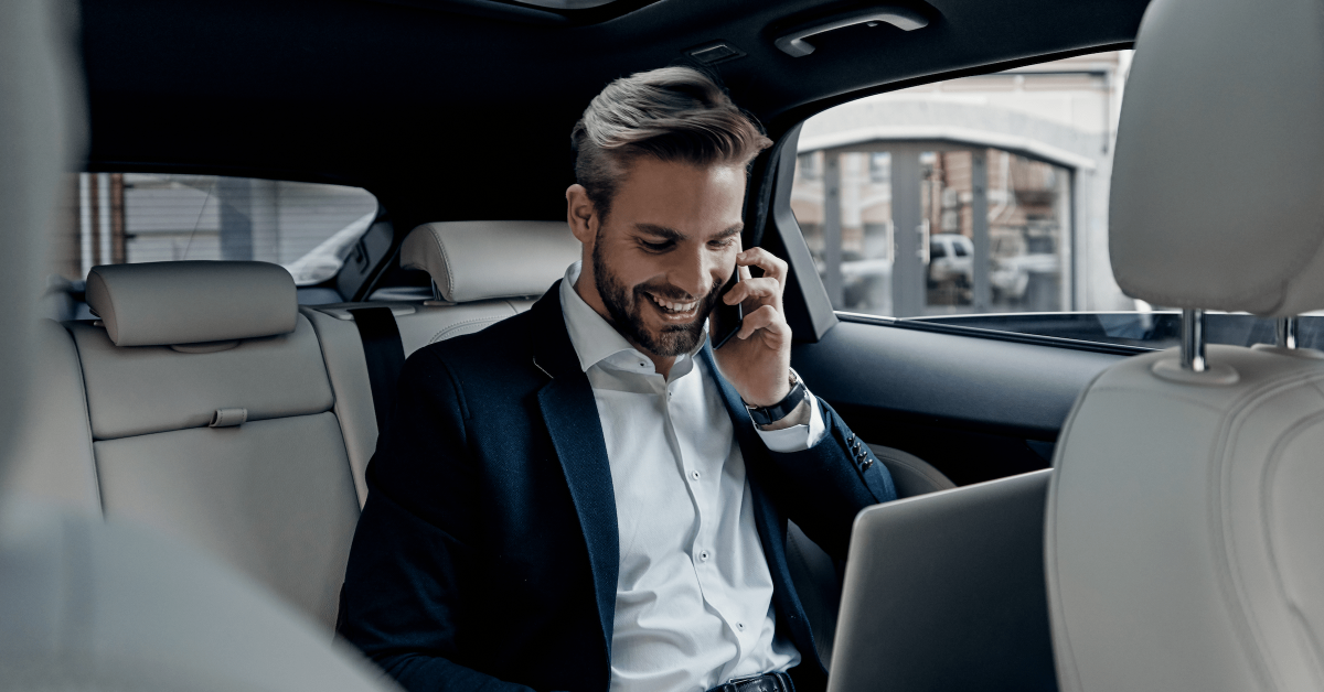 Bolt Business - Man in car on a call, with laptop