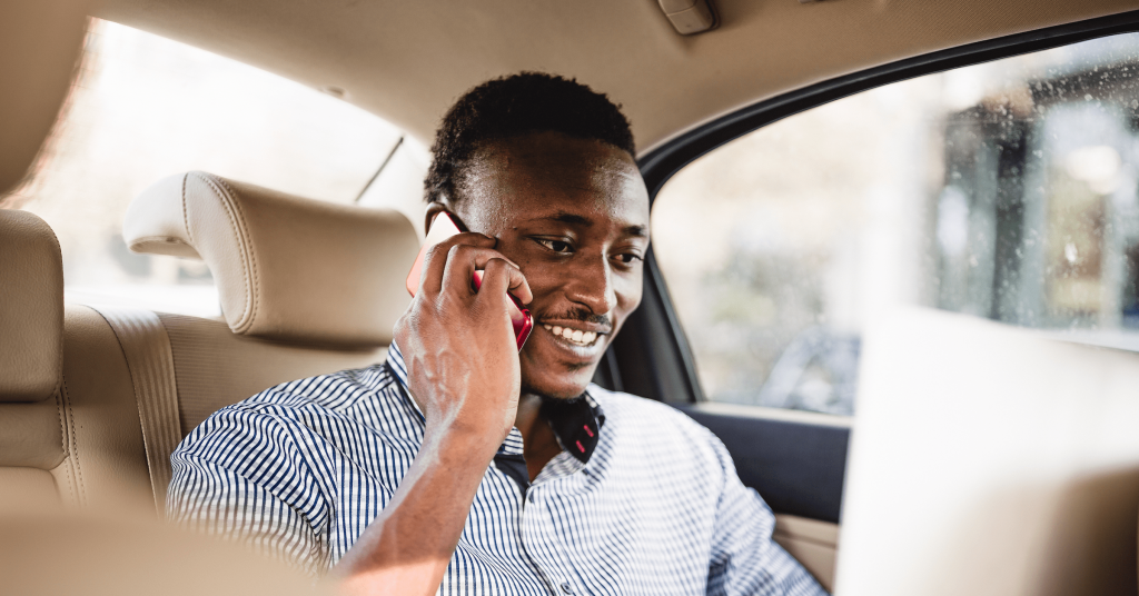 Bolt Business - Man in car on mobile phone