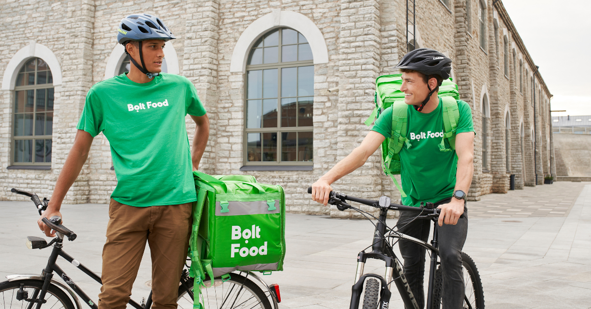 Two couriers Bolt Food with bikes